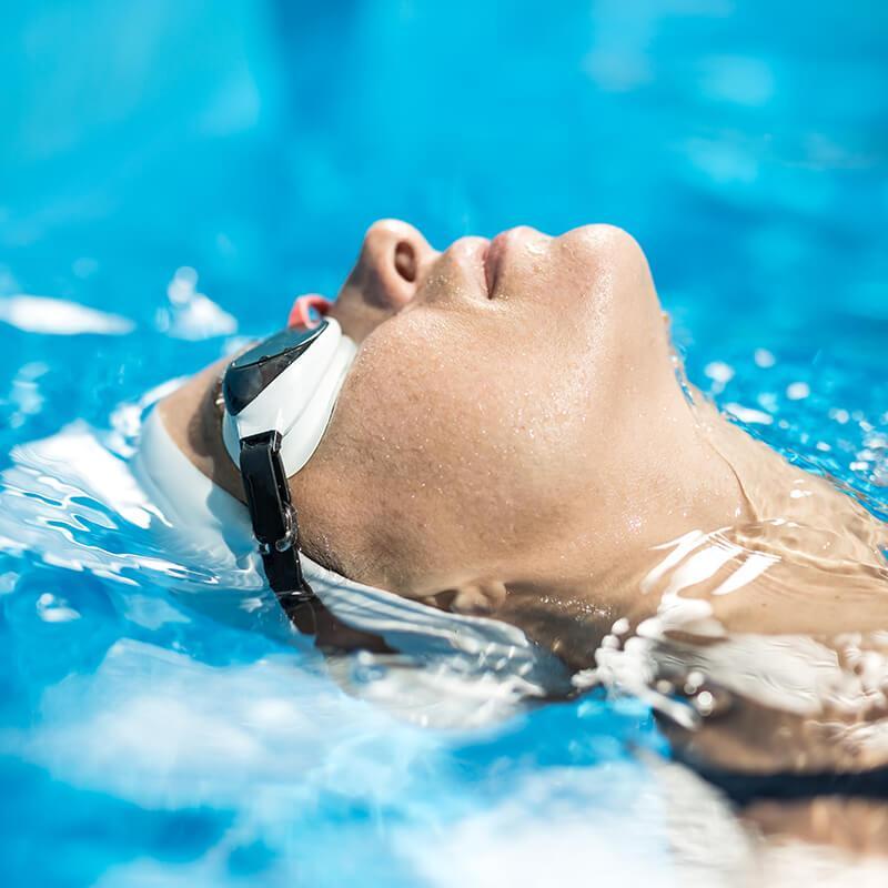 swimmer with swim plugs